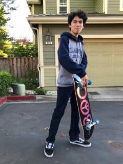 Practicing on his new skateboard